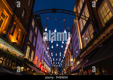 Bright Overhead Illumination in Ganton Street - Stock Photo