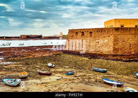 view of La Caleta Beach in Cadiz, with the Castle of Santa Catalina in the foreground ant the Castle of San Sebastian - Stock Photo