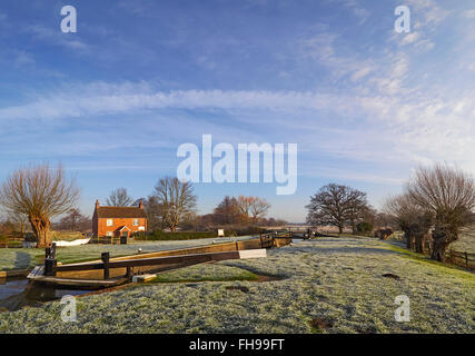 Papercourt lock on the River Wey in Surrey on a still clear frosty winters morning - Stock Photo