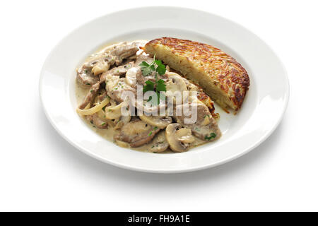 Zurich style veal stew and rosti potato, Swiss cuisine - Stock Photo