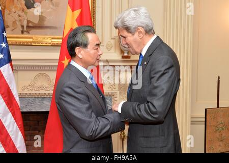 U.S. Secretary of State John Kerry greets Chinese Foreign Minister Wang Yi before their bilateral meeting at the - Stock Photo