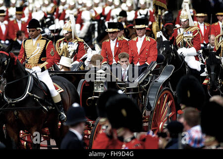 A carriage carrying Princes Andrew and William departs from Buckingham Palace ahead of Queen Elizabeth II on her - Stock Photo