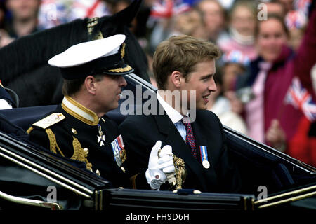 A carriage carrying Princes Andrew (left) and William departs from Buckingham Palace ahead of Queen Elizabeth II - Stock Photo