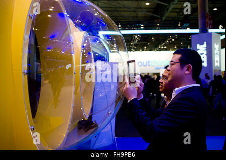 Barcelona, Catalonia, Spain. 24th Feb, 2016. Visitors at Mobile World Congress in Barcelona take pictures of a a - Stock Photo