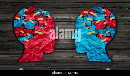 Thinking exchange and idea partnership business communication concept as a red and blue human head cut from crumpled - Stock Photo