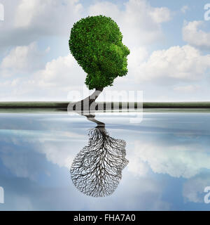 Hidden depression concept and private feelings symbol as a tree with leaves shaped as a human head with a reflection - Stock Photo