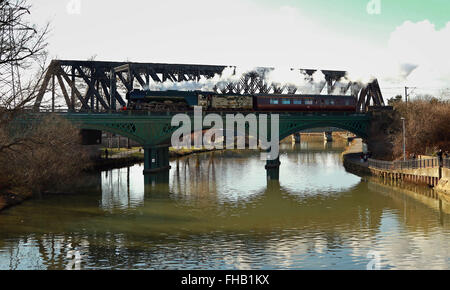 Peterborough, Cambridgeshire, UK. 24th February, 2016. The Flying Scotsman steam train crosses the River Nene in - Stock Photo