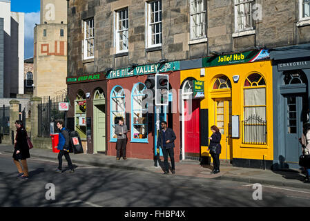 A row of brightly coloured cafés beside the Edinburgh Central Mosque in the University district. - Stock Photo