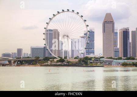 Downtown Singapore as seen from the Marina Bay in the evening - Stock Photo