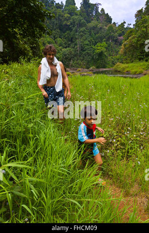 Father and son at the I-Tu WATERFALL on the BOLAVEN PLATEAU near PAKSE - SOUTHERN, LAOS - Stock Photo