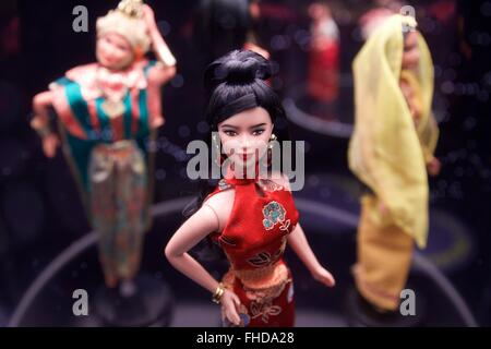 Milan. 24th Feb, 2016. Photo taken on on Feb. 24, 2016 shows a Chinese Barbie doll at the exhibition 'Barbie-the - Stock Photo