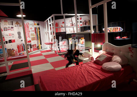 Milan, Italy. 24th Feb, 2016. Two girls plays in 'Barbie's room' at the exhibition 'Barbie-the Icon' in Milan, Italy, - Stock Photo
