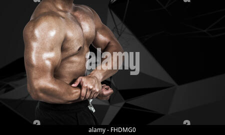 Composite image of muscular man flexing his biceps - Stock Photo