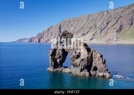 Las Playas Bay with the Roque de Bonanza rock arch, El Hierro, Canary Islands, Spain - Stock Photo