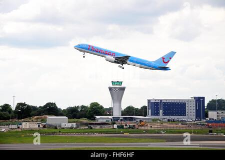 Thomson Airways Boeing 757 200 (G-OOBJ) series taking off over the new control tower at Birmingham Airport, Birmingham, - Stock Photo