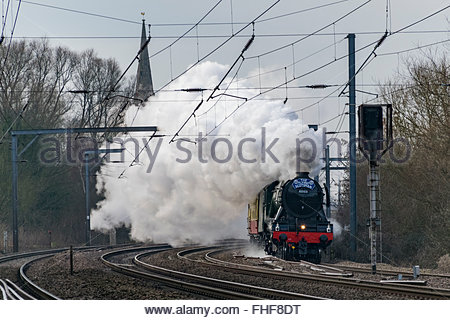 Offord Cluny, Cambridgeshire, UK. 25th February, 2016. The Flying Scotsman, 60103, heads for York on its inaugural - Stock Photo