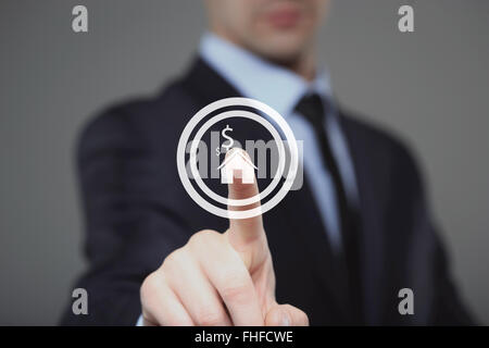 technology and internet concept - businessman pressing House button on virtual screens - Stock Photo