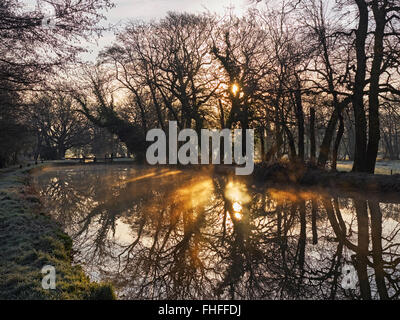 River Wey navigation at Newark lock near Ripley Surrey on a still clear frosty winters morning with contre jour - Stock Photo
