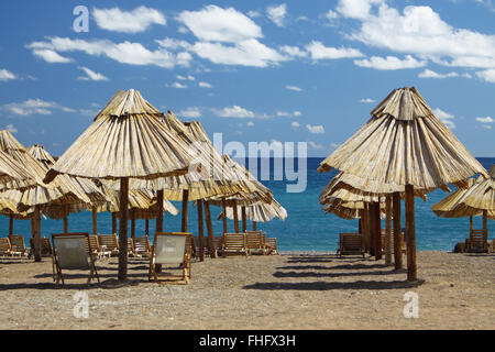 Summer beach with chairs and umbrellas in Montenegro - Stock Photo