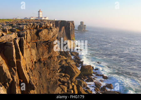 Cabo Carvoeiro in south Portugal . Sunset light and sea mist - Stock Photo