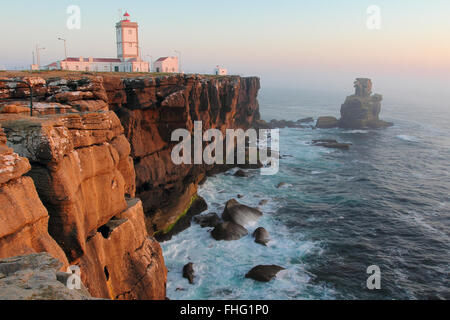 Cabo Carvoeiro lighthouse in sunset light . South Portugal - Stock Photo
