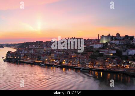 Beautiful Porto cityscape in sunset orange light . - Stock Photo