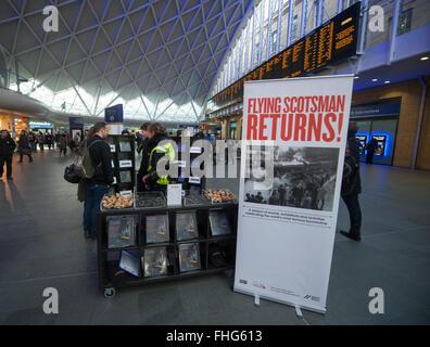 Kings Cross Station, London, UK. 25th February, 2016. National Railway Museum pop-up Flying Scotsman kiosk in Kings - Stock Photo