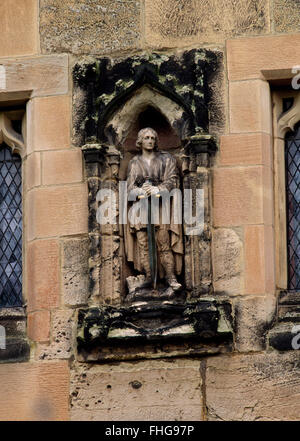 Statue of patron saint & Christian martyr in a niche on the C14th south porch of St Wystan's Church, Repton, Derbyshire. - Stock Photo