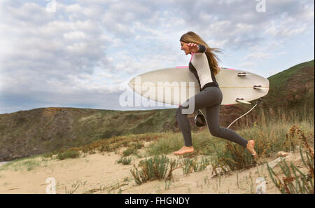 Young surfer woman on the beach - Stock Photo