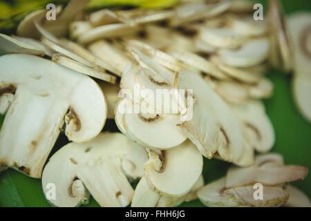 Sliced mushrooms on chopping board - Stock Photo