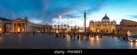 ROME, ITALY - SEPTEMBER 23, 2015 : Front view of St Peter's Basilica in Vatican with people around, on cloudy blue - Stock Photo