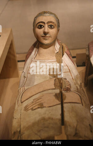 Eastern provinces Roman Empire. Necropolis of Hermopolis, Middle Egypt. Mummy mask of a man with headrest. 3nd century. - Stock Photo