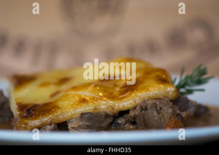 Steak and kidney pie. French restaurant prepared cuisine influenced by a traditional English recipe, presented on - Stock Photo