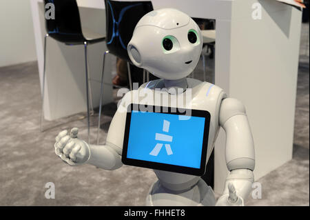 Barcelona, Spain. 25th Feb, 2016. The robot 'Pepper' from Japanese company Softbank communicates with visitors at - Stock Photo