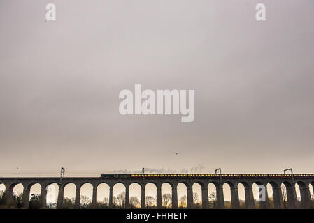 Welwyn Garden City, UK. 25th February 2016. The Flying Scotsman crosses the Digswell viaduct en route to York from - Stock Photo
