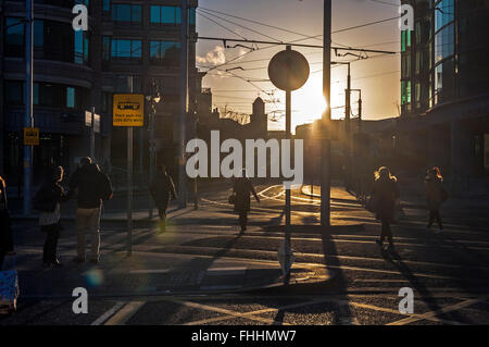 People walking to work in Dublin, Ireland early winter morning - Stock Photo