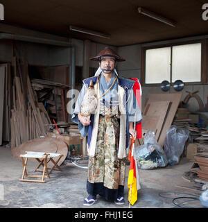 Japan / Fukushima  -  Yoshiyuki, 59, took me to his former house that was also his small furniture factory in Odaka - Stock Photo