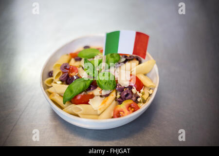 Bowl of pasta with italian flag - Stock Photo