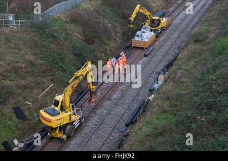 Network Rail staff working on track maintenance during line closure, UK. - Stock Photo