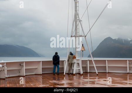 Passengers on board the cruise ship Veendam looking forward on the bow on Beagle Channel. - Stock Photo