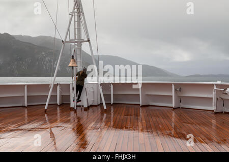 Passenger on board the cruise ship Veendam looking forward on the bow on Beagle Channel - Stock Photo