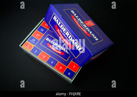 Balderdash bluffing board game on a black background - Stock Photo