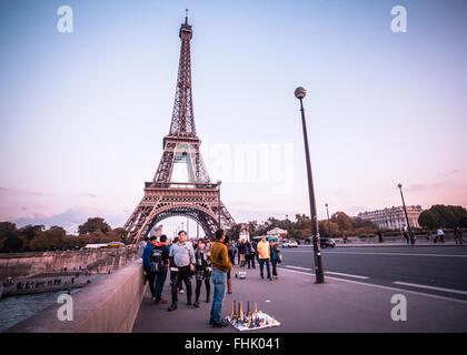 Paris, France - October 9, 2014:  Seen here is a street scene along the Pont d'Iéna bridge towards the Eiffel Tower - Stock Photo
