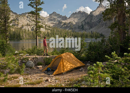ID00431-00...IDAHO - Hiker at campsite at Alice Lake in the Sawtooth Wilderness Area. - Stock Photo