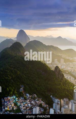 Brazil, Rio de Janeiro showing Cabritos favela, Morro do Sao Joao and the Sugar Loaf - Stock Photo