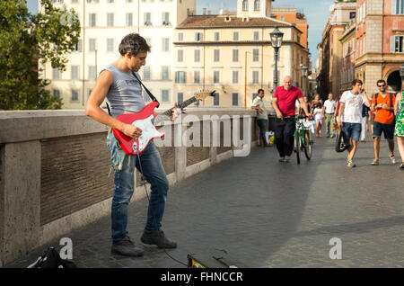 A street performer entertaining tourists and locals on the Ponte Sisto bridge in Rome, Italy. - Stock Photo