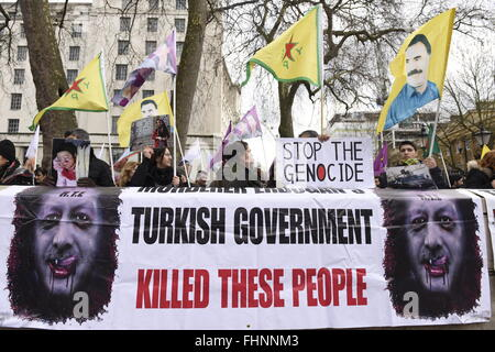 'Stop The Genocide. Turkish Government killed these people.' Placard and banner seen during the Kurdish demonstration - Stock Photo
