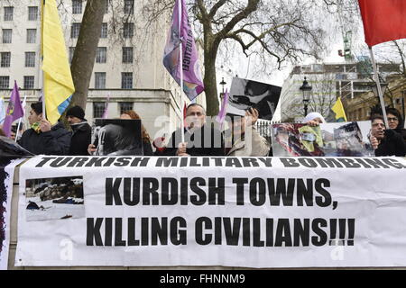 'Turkish military bombing Kurdish towns, killing civilians!'. Banner seen during the Kurds protest in London. - Stock Photo