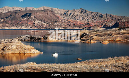A powerboat cruising on Lake Mead - Stock Photo