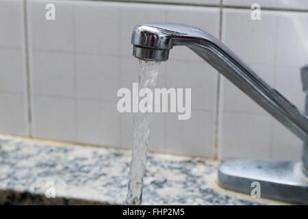 Water running through the sink - Stock Photo